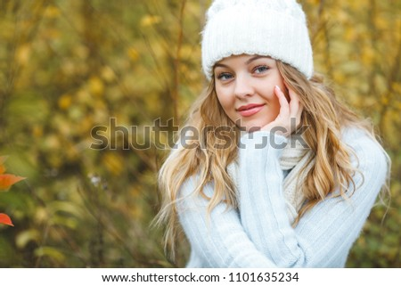 Young attractive woman in autumn colorful background #1101635234