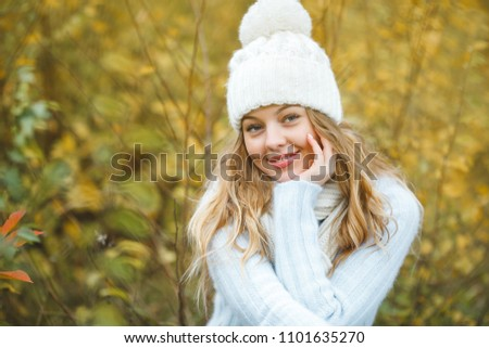 Young attractive woman in autumn colorful background #1101635270