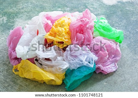 Colorful plastic bag on cement floor background. #1101748121