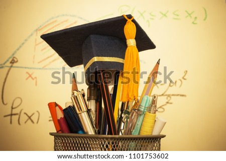 Education Graduate study concept: Graduation hat on pencils with formula arithmetic equation graph on projecter screen at university classroom. Ideas for knowledge learning success and Back to School Royalty-Free Stock Photo #1101753602