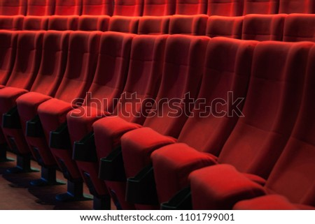 Red empty chairs in the theatre #1101799001