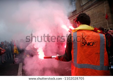 Paris,France,29 May 2018.Protesters of General Confederation of Labour union light flares during a protest protest against the government project to change the status of the railroad workers #1102028705