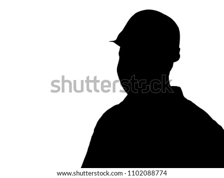 Silhouette of a man in a construction helmet #1102088774