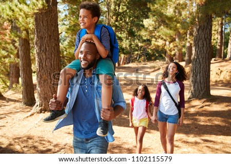 Family On Hiking Adventure Through Forest Royalty-Free Stock Photo #1102115579