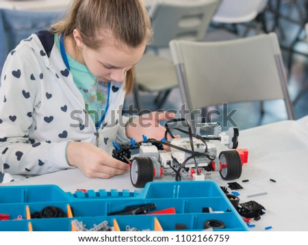 "Minsk, Belarus. May, 2018. ""5th Minsk Open Robotics Tournament"". Robotics competitions. Boys and girls construct and code Robot Lego Mindstorms EV3. STEM. #1102166759"
