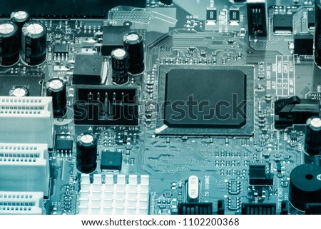 Electronic components mounted on the board of the microcircuit capacitors diodes Picture toned #1102200368
