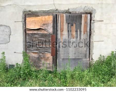 Closed vintage wooden door #1102233095