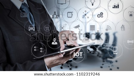 Internet of Things (IOT) technology with AR (Augmented Reality) on VR dashboard. Businessman hand working with a digital tablet on meeting room background #1102319246