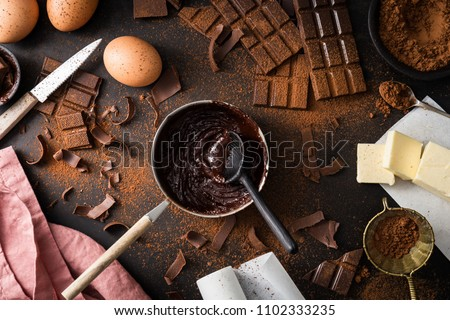 Top View of the process of cooking chocolate bakery pastry with melting chocolate. Ingredients for cooking chocolate  #1102333235