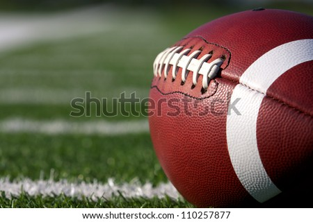 American Football Close up on Field with yard lines in the distance Royalty-Free Stock Photo #110257877