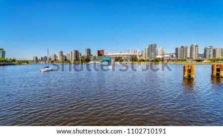 Skyline of the City of Vancouver, British Columbia, Canada as seen from the False Creek Inlet on a clear summer day #1102710191