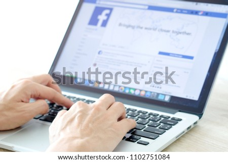 May 25, 2018 Bangkok, Thailand young men use computer laptop internet  looking screen Facebook is social networking service.he surf the Internet to get information of the world. #1102751084