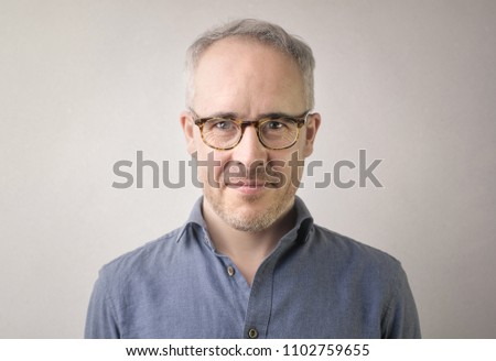 Portrait of a man with eyeglasses #1102759655