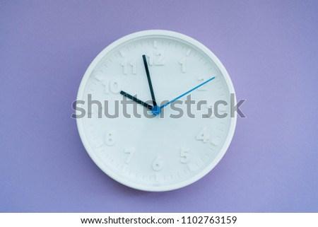 white clock on a lilac background #1102763159