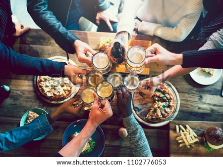 Friends toasting with craft beer #1102776053