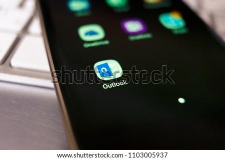 2018.04.23 Kazan, Russia - Microsoft Outlook app logo on Samsung Galaxy S7 Edge phone screen #1103005937