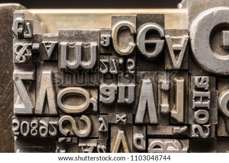 Metal Letterpress Types.  A background from many historical typography letters in black and white with white background.  #1103048744