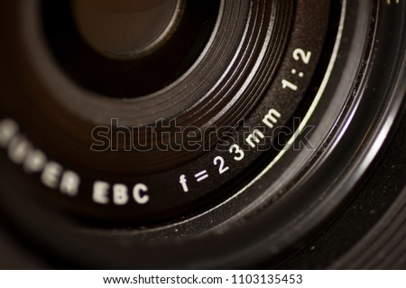Ampang - June 01, 2018: Close up ultra sharp photograph of semi-professional camera lens with UV filter and hood attached. 23mm f2 #1103135453