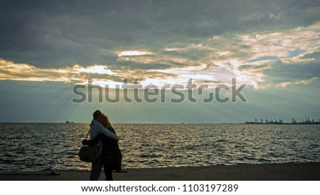 Thessaloniki, Greece, 09/29/2017: a couple embraces at sunset on the promenade of Thessaloniki #1103197289