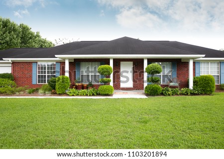 1980's Brick Ranch House in the Suburbs Royalty-Free Stock Photo #1103201894