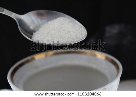 Spoon with sugar #1103204066