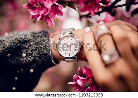 Stylish watch on woman hand Royalty-Free Stock Photo #1103215058
