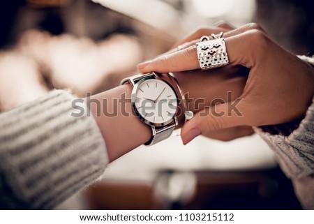 Stylish watch on woman hand Royalty-Free Stock Photo #1103215112