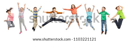 happiness, childhood, freedom, movement and people concept - happy kids jumping in air over white background Royalty-Free Stock Photo #1103221121