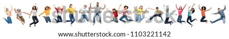 happiness, freedom, motion and diversity concept - happy people jumping in air over white background Royalty-Free Stock Photo #1103221142