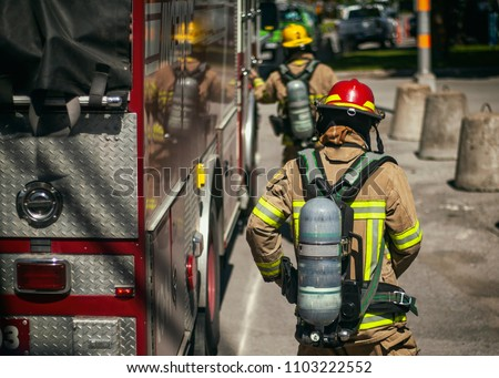 Firefighters walking to the fire truck after responding an emergency call #1103222552