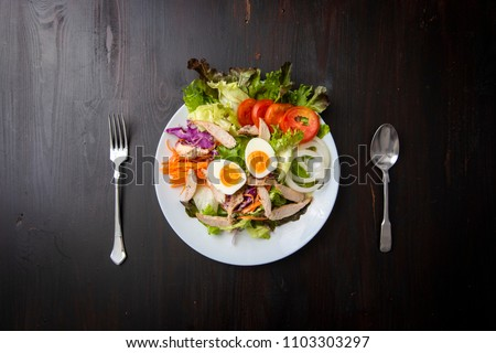 Vegetables Salad on wooden table #1103303297