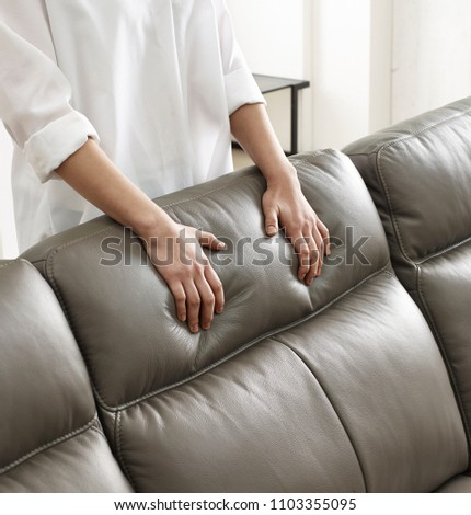 hands on a leather cushion #1103355095