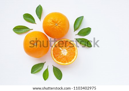 Fresh orange citrus fruit  with leaves on white  background. Juicy and sweet and renowned for its concentration of vitamin C #1103402975