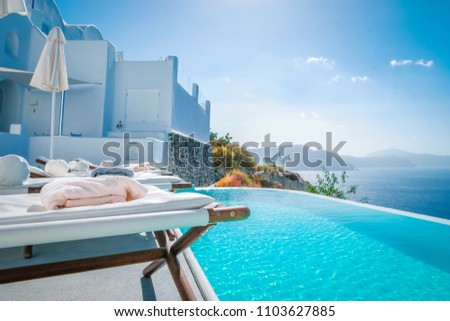 Santorini island Greece September 2017, infinity pool of an luxury hotel resort at the island with whitewashed buildings #1103627885
