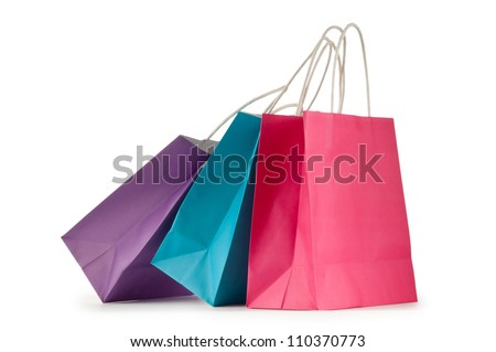 Colourful paper shopping bags isolated on white Royalty-Free Stock Photo #110370773