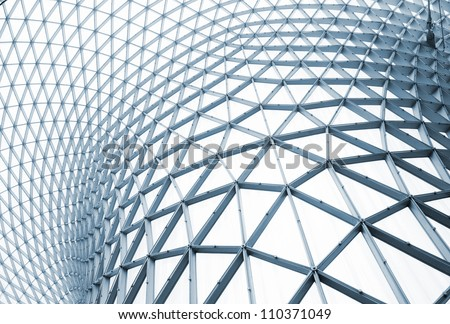 Modern building with curving roof and glass steel column. #110371049