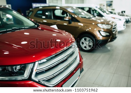 View of row new car at dealership showroom #1103751962