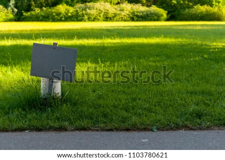 Empty sign in the Park lawn