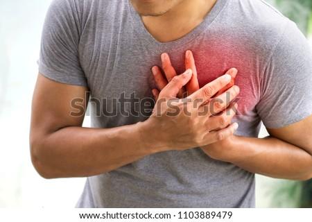 man having heart attack. healthcare concept Royalty-Free Stock Photo #1103889479