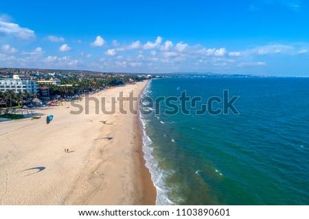 Aerial view of Kitesurfing on the waves of the sea in Mui Ne beach, Phan Thiet, Binh Thuan, Vietnam. Kitesurfing, Kiteboarding action photos