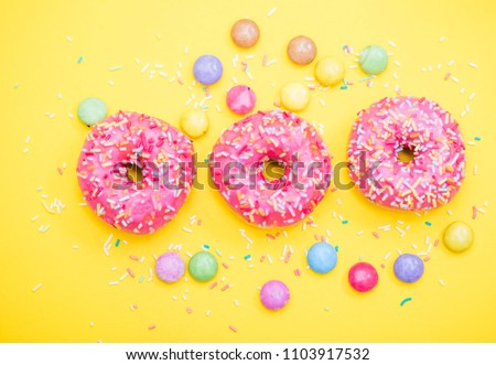pink donuts on yellow background  #1103917532