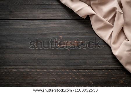 kitchen cloth (napkin) on wood background - vintage effect filter #1103952533