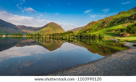 Beautiful sunset at lake in District Lake England, Europe Royalty-Free Stock Photo #1103990120