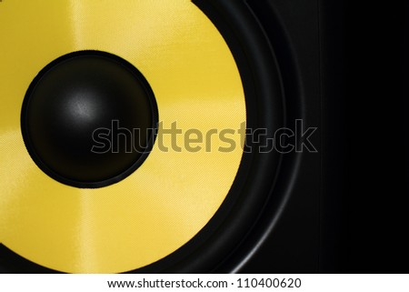 Closeup of a yellow speaker sub woofer #110400620