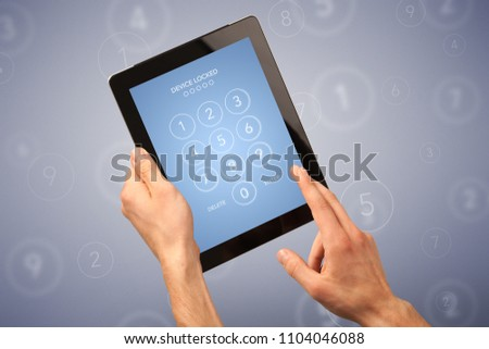Female fingers touching tablet with locked device requiring passcode #1104046088