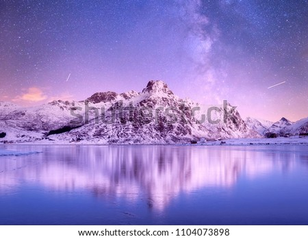 Night sky and reflection on the frozen lake. Natural landscape in the Norway #1104073898