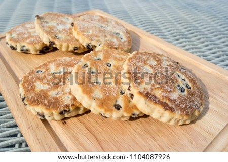 Welsh cakes presented on a wooden board
