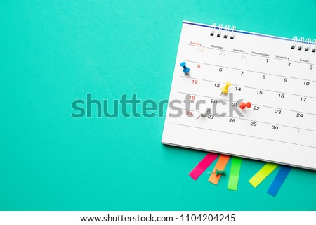 close up of calendar on the table with green background, planning for business meeting or travel planning concept