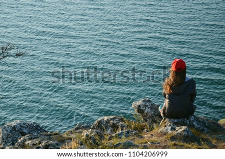 Dreamer. Girl on the background of the sea #1104206999