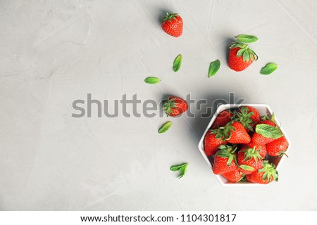 Flat lay composition with ripe red strawberries and mint on light background #1104301817